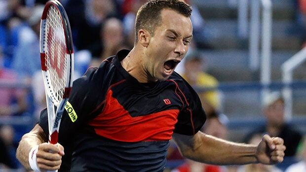 Germany's Philipp Kohlschreiber celebrates his upset victory over American John Isner at the U.S. Open on Saturday.
