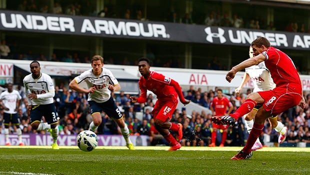 Liverpool captain Steven Gerrard (8) scores from the penalty spot in a 3-0 victory over Spurs at White Hart Lane on Sunday.