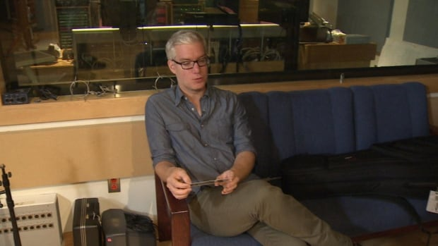 Newfoundland musician Ian Foster spent about four hours sitting in a French border customs area after he was prevented from playing a St-Pierre gig because he lacked the paperwork needed to do so.