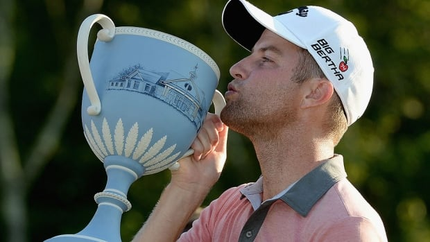 Chris Kirk is presented with the winner's trophy after winning the Deutsche Bank Championship at the TPC Boston on Monday in Norton, Mass.  He closed with a 5-under 66 for a two-shot victory over Russell Henley, Billy Horschel and Geoff Ogilvy.