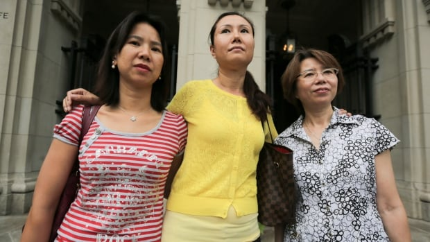 Three would-be buyers in the Centrium Condo project were relieved Tuesday after learning a judge had approved the release of their deposit money. From left to right are Ada Huang who had deposited $60,000; Linda Jin ($59,000) and Sue Lin ($80,000).