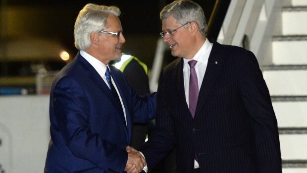 Prime Minister Stephen Harper, right, arrived in London late Tuesday where he was greeted by Gordon Campbell, Canada's high commissioner to the U.K.