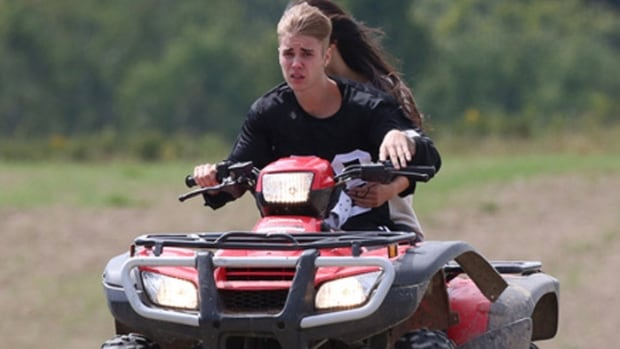 Justin Bieber has been charged with assault and dangerous driving after a crash involving a minivan and an ATV in southwestern Ontario. TMZ published photos of Bieber and Selena Gomez driving an ATV on Friday near his father's Ontario home.