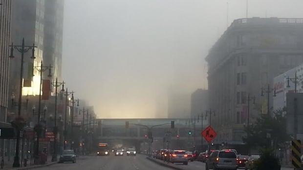 Fog shrouds the downtown Winnipeg skyline on Wednesday morning.