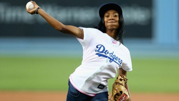 Little League World Series star Mo'ne Davis throws out the ceremonial first pitch prior to the start of the game between the Los Angeles Dodgers and the Washington Nationals at Dodger Stadium Tuesday.