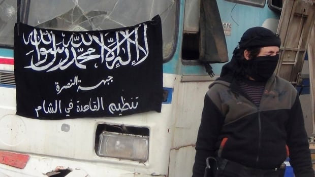 A member of Islamist Syrian rebel group Jabhat al-Nusra mans a checkpoint on the border crossing between Syria and Jordan. CBC News has confirmed at least three Canadian members of the militant group were directly involved in the detention and interrogation of U.S. journalists Theo Curtis and Matt Schrier.