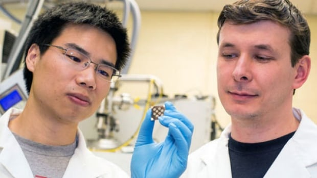 Professor Sargent's lab members, Zhijun Ning and Oleksandr Vozny, examining a new paint-on solar chip.