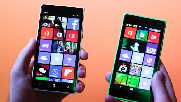 The new Lumia 830 (left) and 730 smartphones were unveiled during a Microsoft Nokia presentation at the consumer electronic fair IFA in Berlin Thursday. The 730 will have features designed for better selfies and video calls.