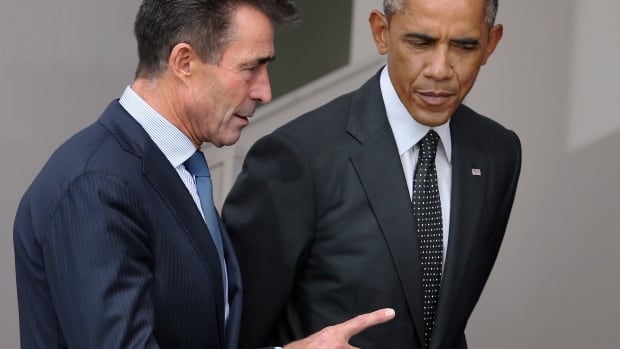 U.S. President Barack Obama, right, talks with NATO Secretary General Anders Fogh Rasmussen at the alliance's summit in Wales this week. Obama has offered assurances to NATO's Baltic state members against Russia's aggression.