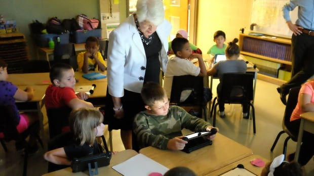 Ontario Education Minister Liz Sandals, centre, announced $150 million in funding over the next three years for school boards to invest in technology for their classrooms. Sandals made the announcement during a visit to Dr. J. Edgar Davey Elementary in downtown Hamilton on Thursday.
