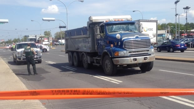 A dump truck hit a pedestrian while making a turn at the corner of Newman Boulevard and Thierry Street in LaSalle.