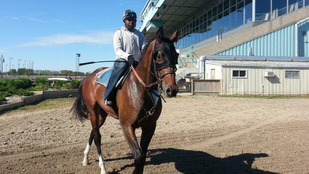 Jockey Orville Beckford rides Premier Wall.