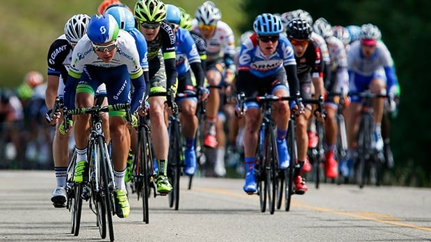 Cyclists sprint uphill near Sylvan Lake in the second stage of the Tour of Alberta on Thursday.