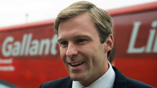 Liberal Leader Brian Gallant talks with reporters near his campaign bus in Dieppe on Aug. 21.