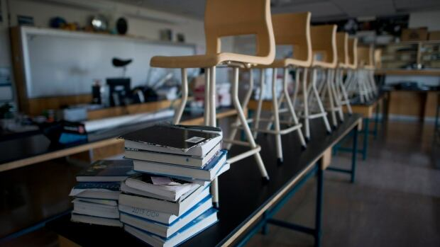 Chairs are seen on top of desks in a physics lab at Magee Secondary school in Vancouver, B.C. Friday, Sept. 5, 2014.
