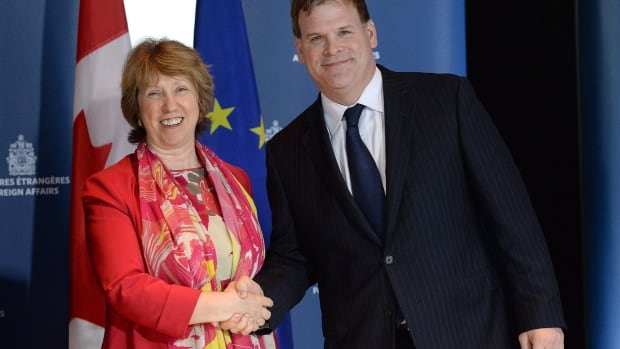 EU foreign policy chief Catherine Ashton shakes hands with Foreign Minister John Baird in Ottawa today. The two governments signed an agreement on co-operation in areas of law enforcement, organized crime, cybercrime, money laundering, research co-operation and energy security.