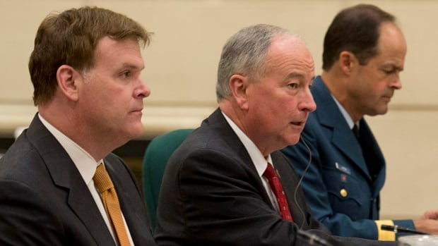 Foreign Affairs Minister John Baird, Defence Minister Rob Nicholson and Chief of Defence Staff Tom Lawson (left to right) took questions Tuesday from the foreign affairs and international development committee about a 30-day deployment to Iraq.