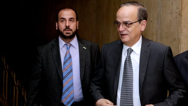 The head of  Syrian Coalition (SNC), Syria's main political opposition group, Hadi Bahra, right, seen on Sept. 8, welcomed the substance of Barack Obama's televised speech regarding Syria.