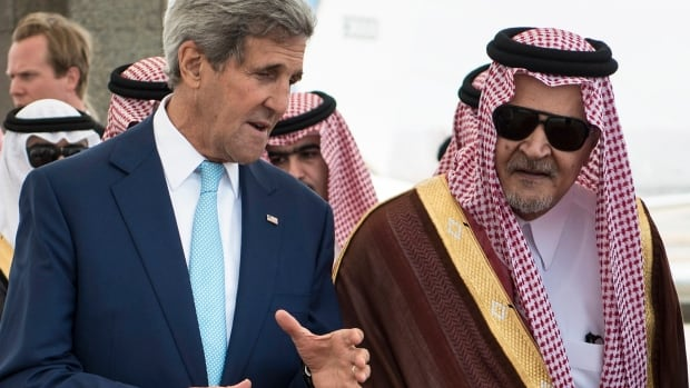 U.S. Secretary of State John Kerry, left, speaks with Saudi Foreign Minister Prince Saud al-Faisal, right, upon his arrival in Jiddah, Saudi Arabia, on Monday. Kerry is in the region to build support for the U.S.-led effort to fight ISIS.