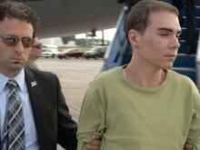 Luka Rocco Magnotta is taken by police from a Canadian military plane to a waiting van on Monday, June 18, 2012 in Mirabel, Que.