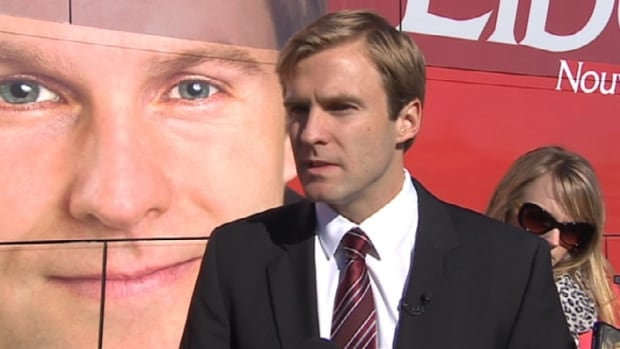 Liberal Leader Brian Gallant speaks to reporters on Sept. 12 after voting in his riding. He defended his party's tax plan that would raise rates on the wealthiest in the province.