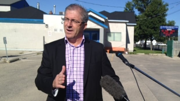 Gord Steeves explains his community club funding plan to reporters on Friday.