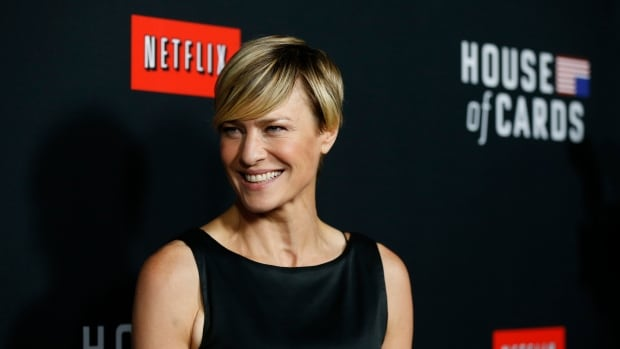 Robin Wright, one of the stars of the Netflix series House of Cards, poses at the premiere for the second season of the show.  The success of its original series has emboldened the web streaming service, and it is launching a  $400 million international expansion on Monday. In Europe, many countries already have established streaming services and fear Netflix will encroach on their territory.