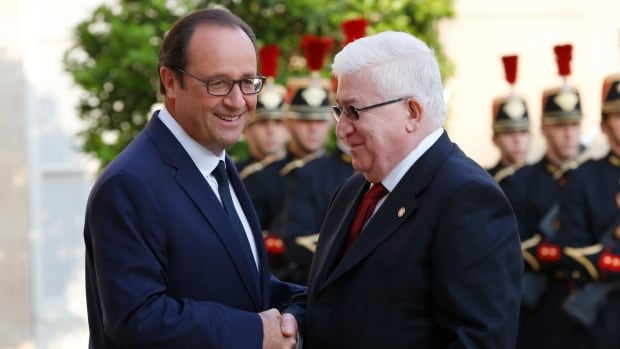 French President François Hollande greets Iraq's President Fuad Masum ahead of a conference bringing together about 30 countries to discuss how to co-operate in the fight against militants of the Islamic State in Iraq and Syria (ISIS).