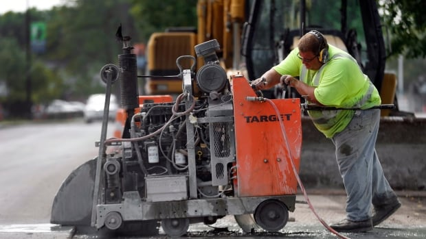 Rick Haggadone cuts pavement concrete in Detroit on Sept. 4, 2014.  U.S. states, including Michigan, are struggling with how to pay for roads and other infrastructure as revenue growth slows.