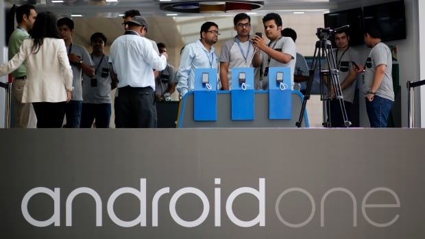 Visitors look at Android One Based mobiles after its launch in New Delhi Sept. 15. Google's 'Android One' initiative which is aimed at boosting sales in key emerging markets through cheaper prices and better quality software.