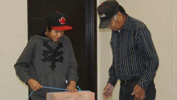 Student and elder take part in the KiHS program in Poplar Hill First Nation