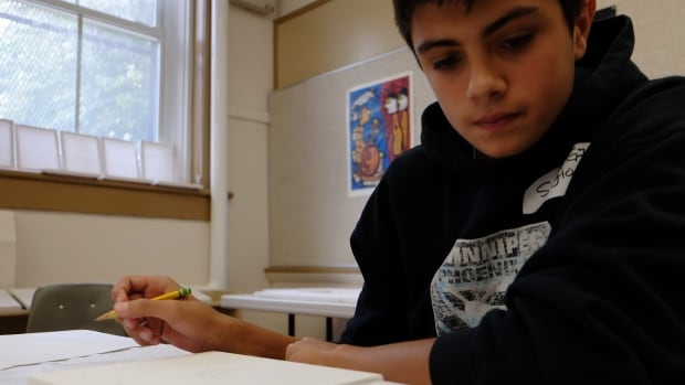 It's back to pencil and paper for students taking Ontario's literacy tests.