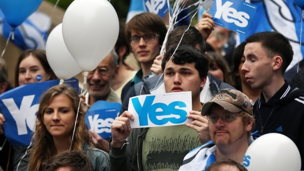 Yes campaign supporters attend a rally in Glasgow, Wednesday, a day before Scotland's referendum on independence. Scottish residents 16 years of age and older are eligible to vote.