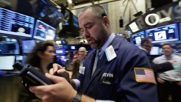 Trader Kevin Lodewick works on the floor of the New York Stock Exchange. U.S. and Canadian indexes are falling from the record levels reached at the end of the summer.
