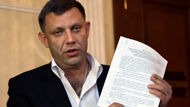 Alexander Zakharchenko, the leader of pro-Russian rebels in Donetsk, speaks to the media after peace talks in Ukraine in Minsk, Belarus, early Saturday, Sept. 20, 2014. Participants in Ukrainian peace talks agreed early Saturday to create a buffer zone to separate government troops and pro-Russian militants and withdraw foreign fighters and heavy weapons from the area of conflict in eastern Ukraine.