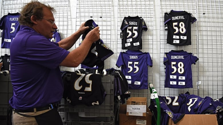 e70739be5ef A Baltimore Ravens vendor sorts through replacement jerseys during the Ray  Rice jersey exchange at M&T Stadium on Friday. (Patrick Smith/Getty Images)
