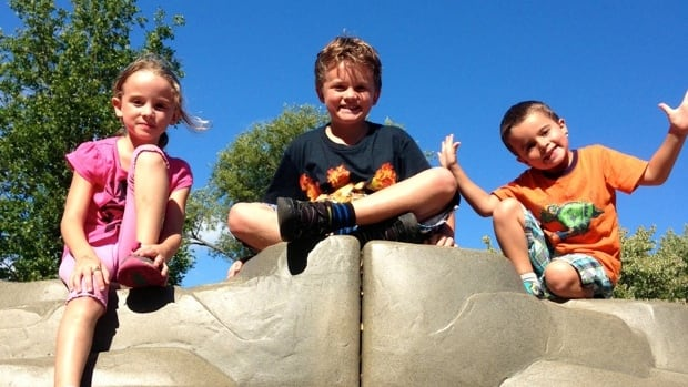 Laurence, who has ADHD, Antoine and Olivier, left to right, play 'like normal kids,' says their mother, Sarah Cloutier, of Salaberry-de-Valleyfield, Que. Cloutier and her husband are upset over a letter they received complaining about the children's screaming while outdoors.