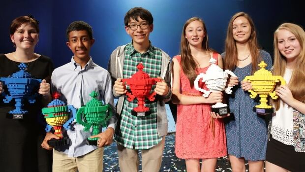 Canadian Hayley Todesco, Americans Mihir Garihella and Kenneth Shinozuka, and Ciara Judge, Émer Hickey and Sophie Healy of Ireland, left to right, were awarded Google Science Fair trophies Monday.