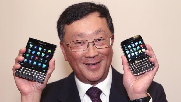 BlackBerry CEO John Chen shows off the new Passport, left, and Classic phone models at the company's annual general meeting this June. The Passport, by the Waterloo, Ont.-based company, was officially released Wednesday.