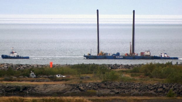 Barges have already arrived in Cacouna, Que., to start the exploratory work, but a court injunction prevents TransCanada from proceeding until Oct. 15.