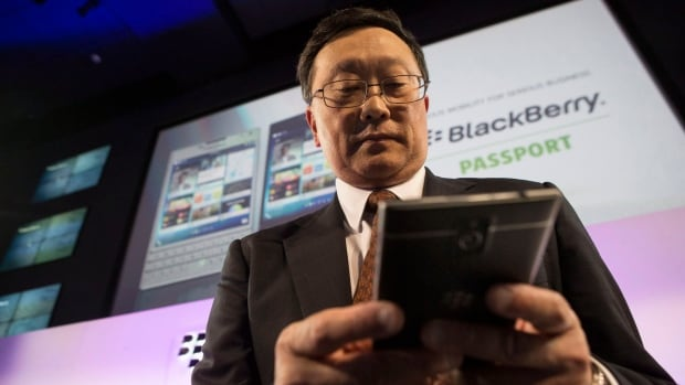 BlackBerry CEO John Chen sends a message on his new Passport device following its launch in Toronto. Chen took over the reins of BlackBerry back in November 2013.