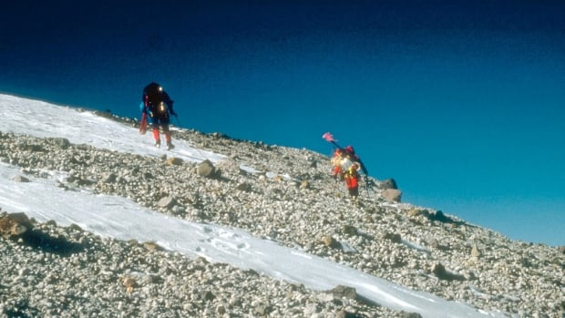 Staff from the U.S. Geological Survey reach the east rim of the summit caldera on Mount Churchill in Alaska, site of one of the biggest volcanic eruptions in North America in the last 2,000 years. Ash from the eruption reached Europe, researchers have found.