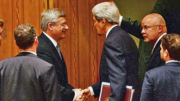 Prime Minister Stephen Harper shakes hands with U.S. Secretary of State John Kerry after speaking at the UN Security Council Wednesday. It's the place to meet influential people.