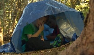 Students play in a tent at Cloudberry Forest School