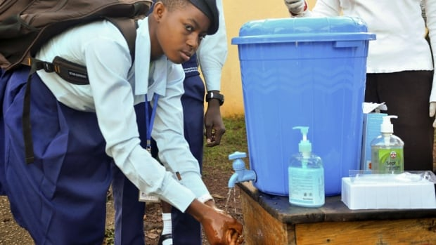 A student of Government Secondary School Garki washes her hands, as school resumed in Abuja, Nigeria, in September. As of Sept. 26, there had been 20 cases of Ebola in Nigeria, including eight deaths.