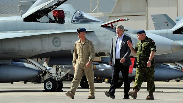 Stephen Harper gets a tour of Canada's CF-18's in Trapani, Italy, in September 2011 in the aftermath of the Canadian and UN intervention in the Libyan civil war.