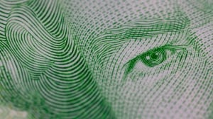 The Queen's face is seen on a twenty dollar bill. Although the Canadian dollar hasn't been looking too great compared to the U.S. dollar, it's a popular currency for other countries to keep in their stockpiles, IMF data showed this week.