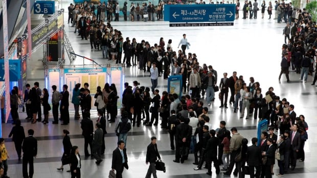 South Korean job-seekers line up to apply for jobs during an job fair in Busan. Canada is a top destination for global job-seekers.