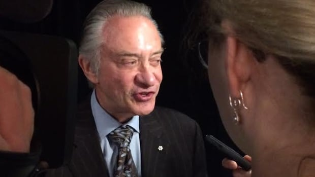 Postmedia CEO Paul Godfrey earned $518,750 in bonuses this year even as his company eliminated jobs and racked up losses.