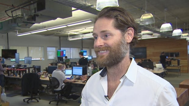 Hootsuite founder and CEO Ryan Holmes, seen here in his offices in Vancouver in this Oct. 2014 photo, is raising concerns about the federal government's proposed changes to small-business taxation.